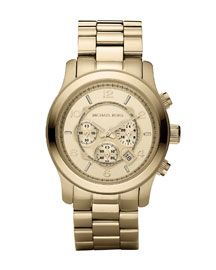 Michael Kors oversized gold watch, ready for the runway.