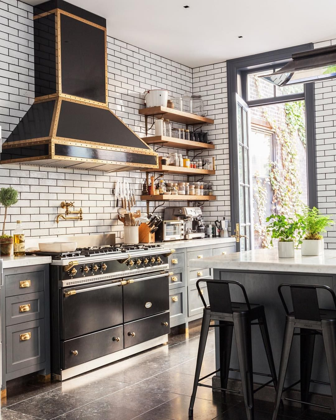 Designed With A Black Stove As The Clear Centerpiece And Walls Covered In Subway Tile The Round Back Dining Chairs Kitchen Dining Room Farmhouse Table Chairs