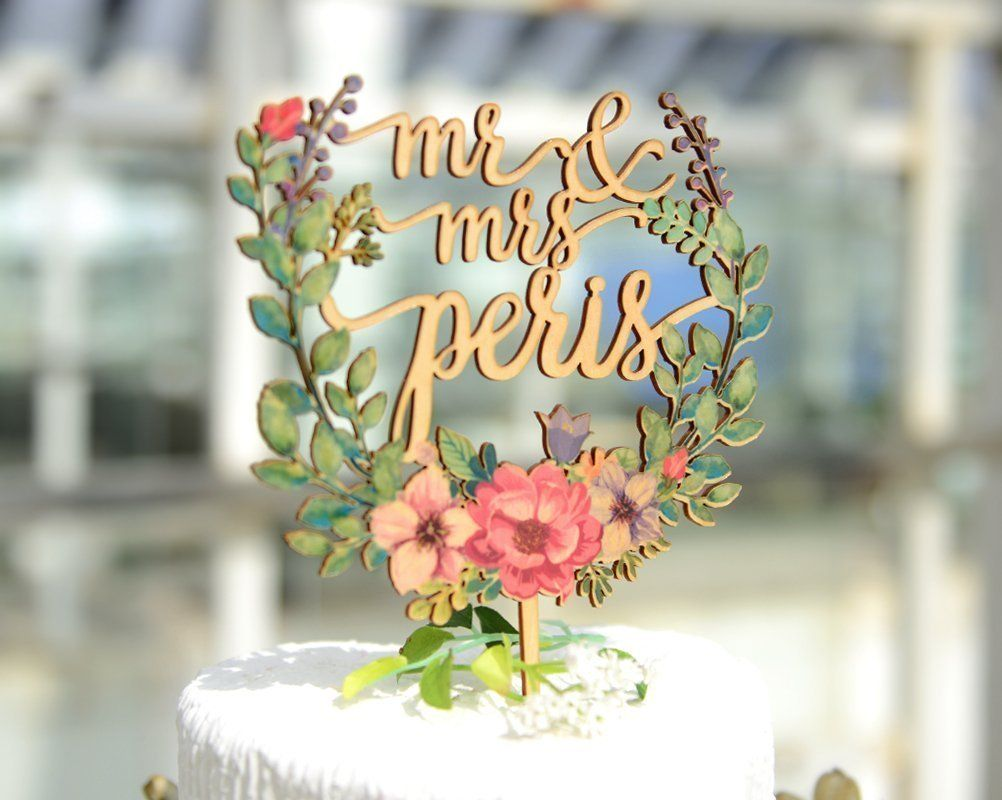 Floral wreath style wedding cake topper with name mr u mrs wedding