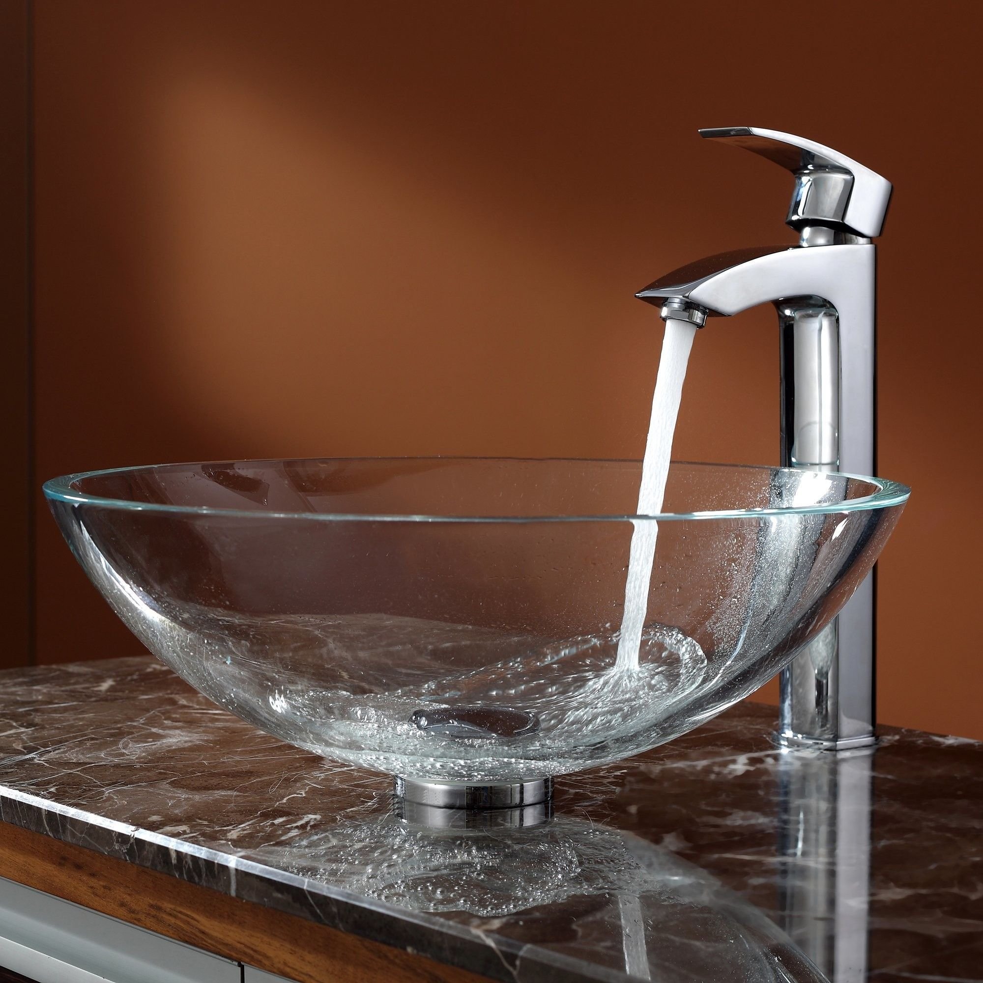 Features:  -Faucet: All mounting hardware and hot/cold waterlines are included.  -Add a touch of elegance to your bathroom with a glass sink combo from Kraus.  -Stylish crystal clear glass sink and Vi