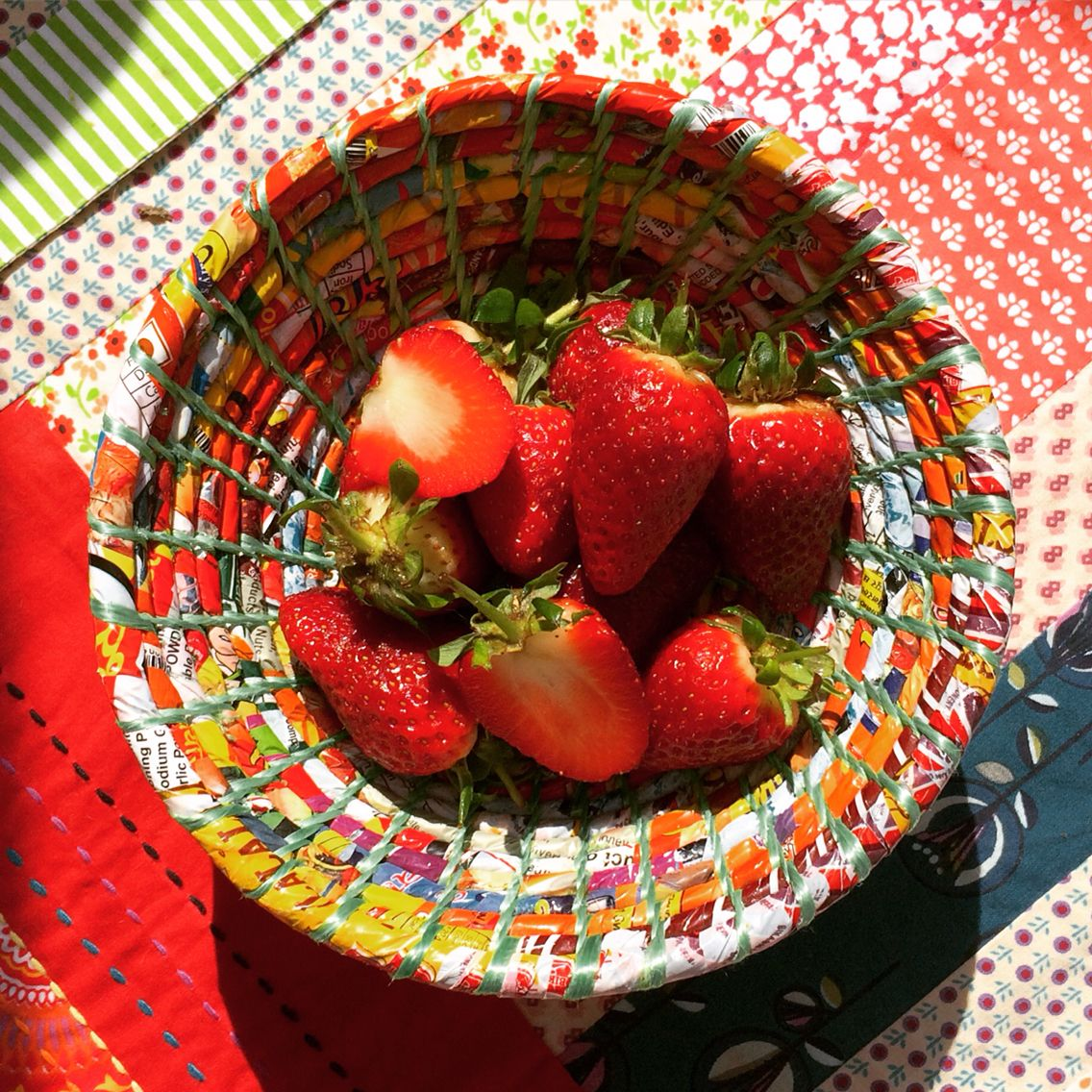 Strawberries in a bowl made from recycled sweet wrappers