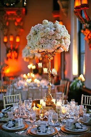 Tall Roses Wedding Centerpieces. http://memorablewedding.blogspot.com/2014/01/top-5-wedding-flowers-to-pick-for-your.html