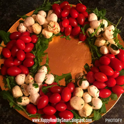Caprese salad wreath, this dish is super easy to prepare and adds a festive touch to your holiday party. (Healthy Christmas Recipes)