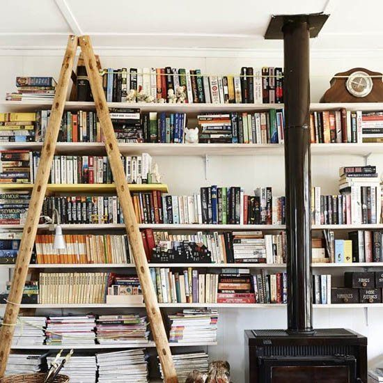 Is there anything dreamier than a wall of shelves filled from top to bottom with books? (via the design files)