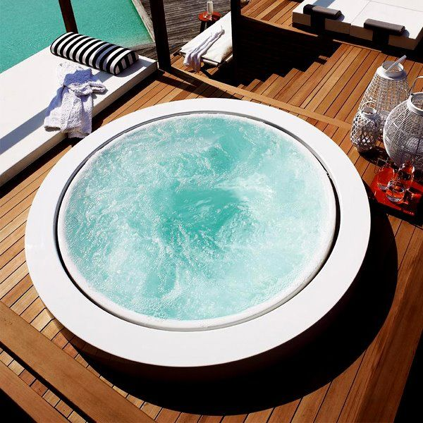 the perfect ambience with this free standing version of a minipool by Zucchetti Kos including hydromassage