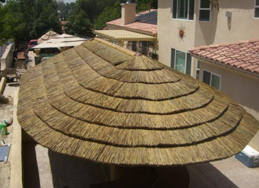 African Thatch Is A Great Rooftop Material Because It S An Insulator That Helps Regulate Warm Cool Air During Different Seaso Thatched Roof Thatch Tiki Decor