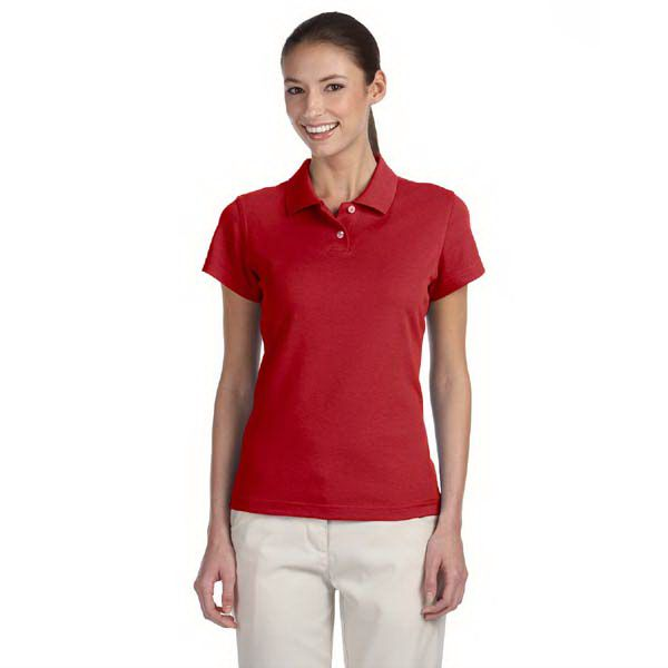 """Adidas Golf ladies ClimaLite (R) Tour pique short-sleeve polo shirt. 55% cotton, 45% polyester with hydrophilic finish. Side-seamed with bottom vents and drop tail. Lighter weight smooth fabric with an improved hand. Rib knit collar. ClimaLite (R) heat-seal logo on lower left side-seam. Adidas performance logo on right sleeve. Contrast 3-stripes at center back yoke, 1 3/4"""" x 4"""" long. Two-button placket. Set-in open-hem sleeves."""
