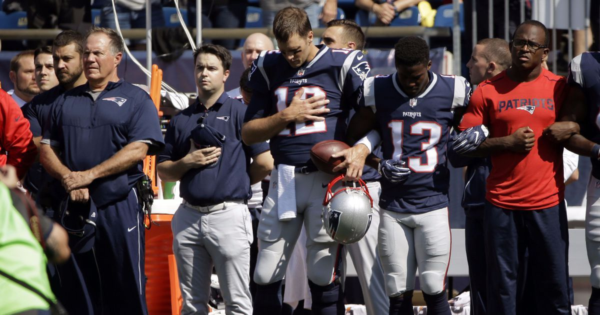 Trumps buddy Tom Brady links arm with teammate during national anthem