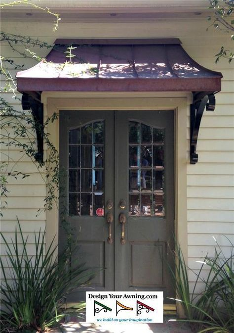 Awnings On French Doors The Metal Juliet Awning Over Front Door In Zionsville In Bronze 4 Front Door Awning Door Awnings Metal Awning