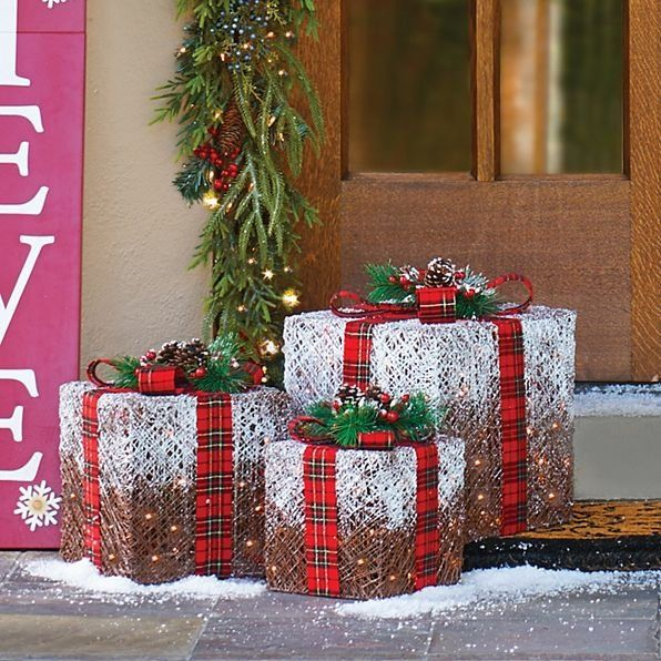 decorate your home with elegantly wrapped frosted lighted presents outdoor christmas decorations theyre