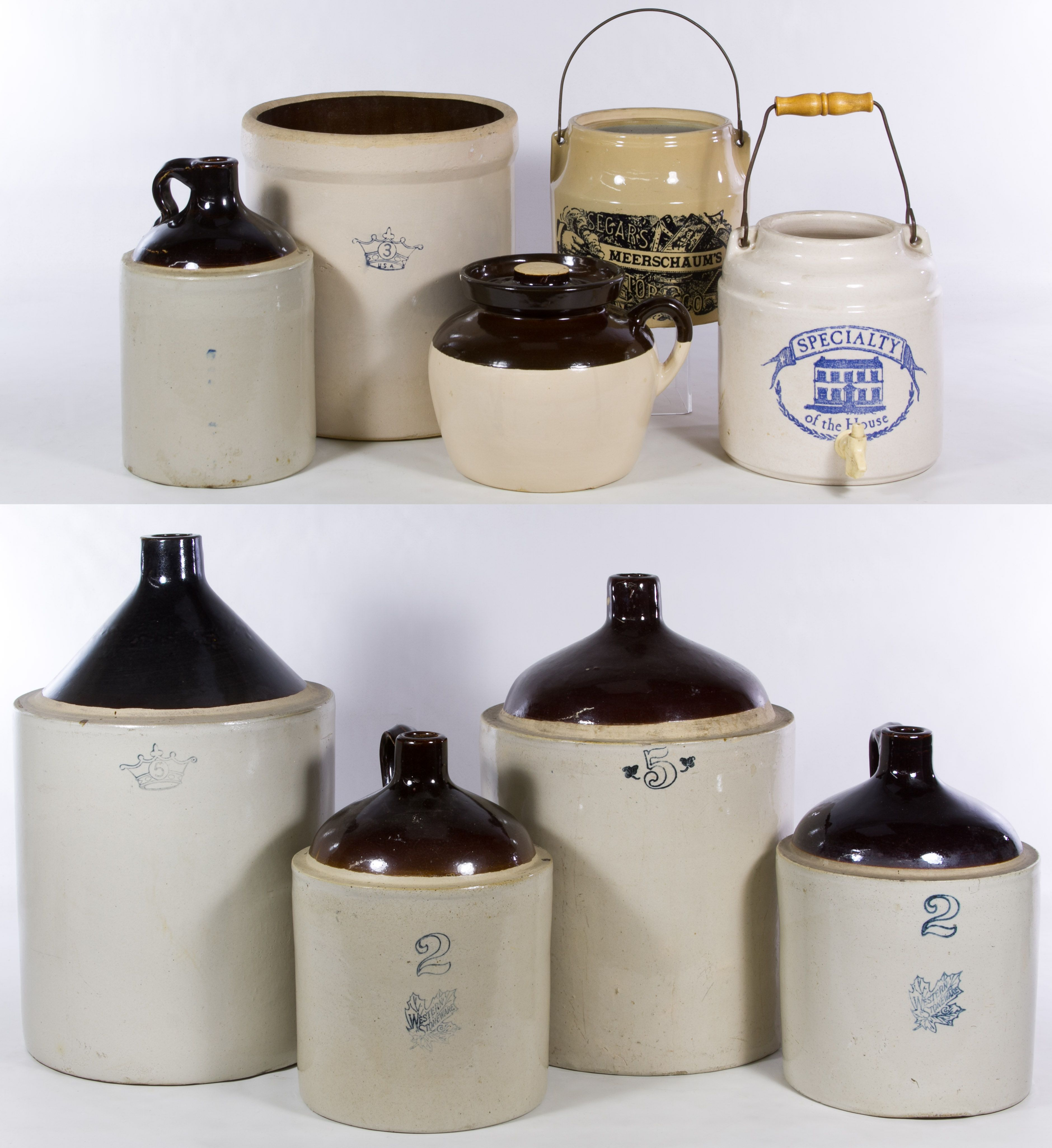 Lot 461: Jug and Crock Assortment; Including five brown top jugs, two metal bale crocks, a covered crock with a handle and an open crock with examples from Western Stoneware, Meerschaum, Specialty and a crown mark
