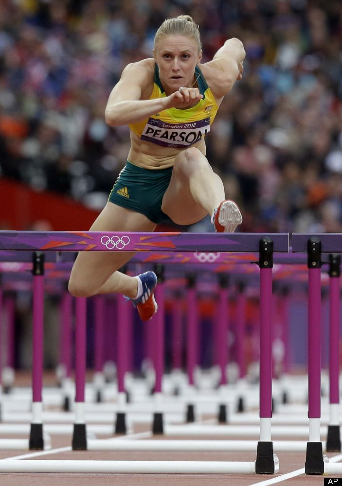 Australia's Sally Pearson jumps in a women's 100-meter hurdles semifinal  during the athletics in