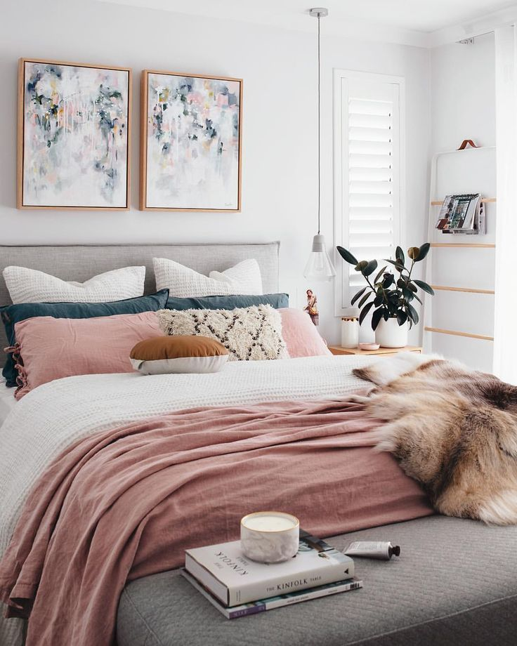 . A chic modern bedroom with a white  gray  and blush pink color