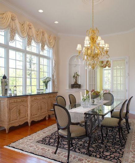 High Ceilings French Doors And A Niche Set The Stage For This Eclectic Dining Room Bau Manufacturing Buffet Has Crackled Finish Stone Top While