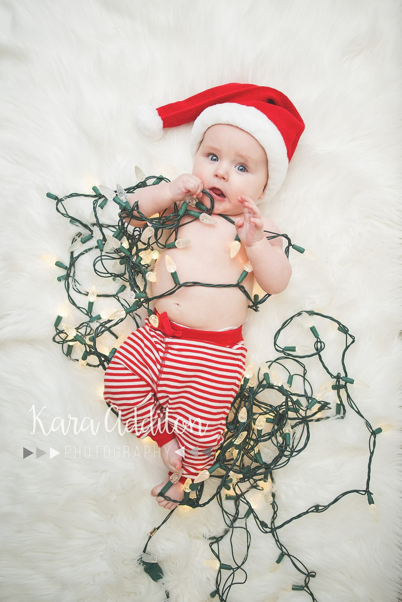 7083dbe9bb2e2 Baby s first Christmas holiday photoshoot lights Santa hat and Christmas  pj s
