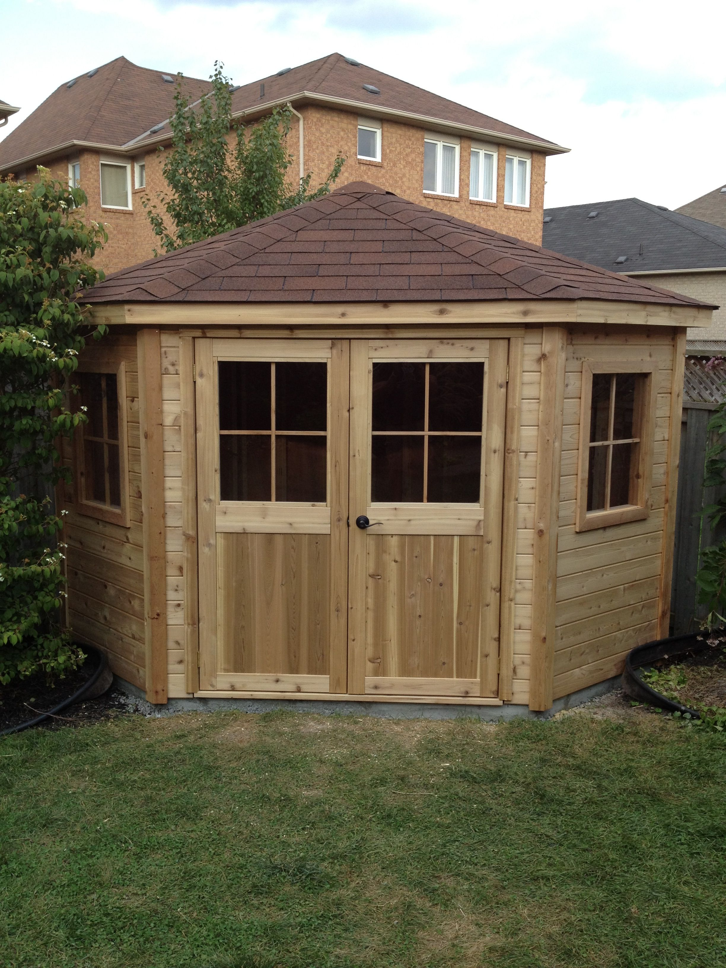 8x8 Cedar pentagon shed custom built and designed by RenoNate
