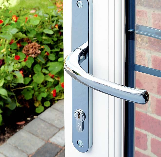 Close Up View Of A Silver Handle On An Everest White Upvc French