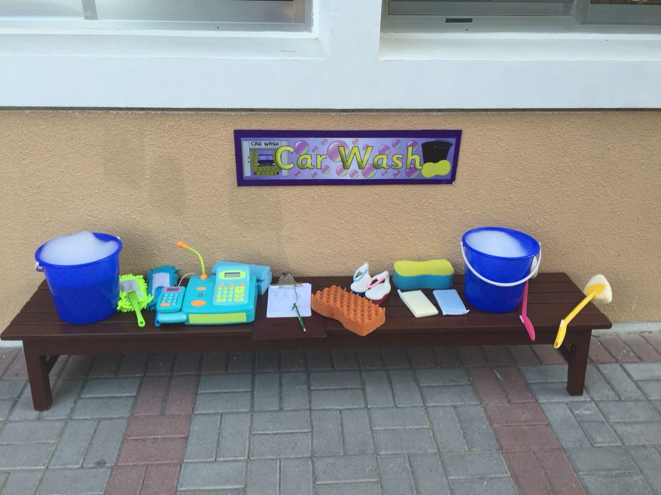 Car wash outdoor classroom washing the bikes! Eyfs
