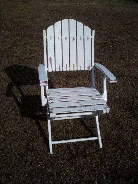 Took a new folding lawn chair and sanded it down to make it look older.