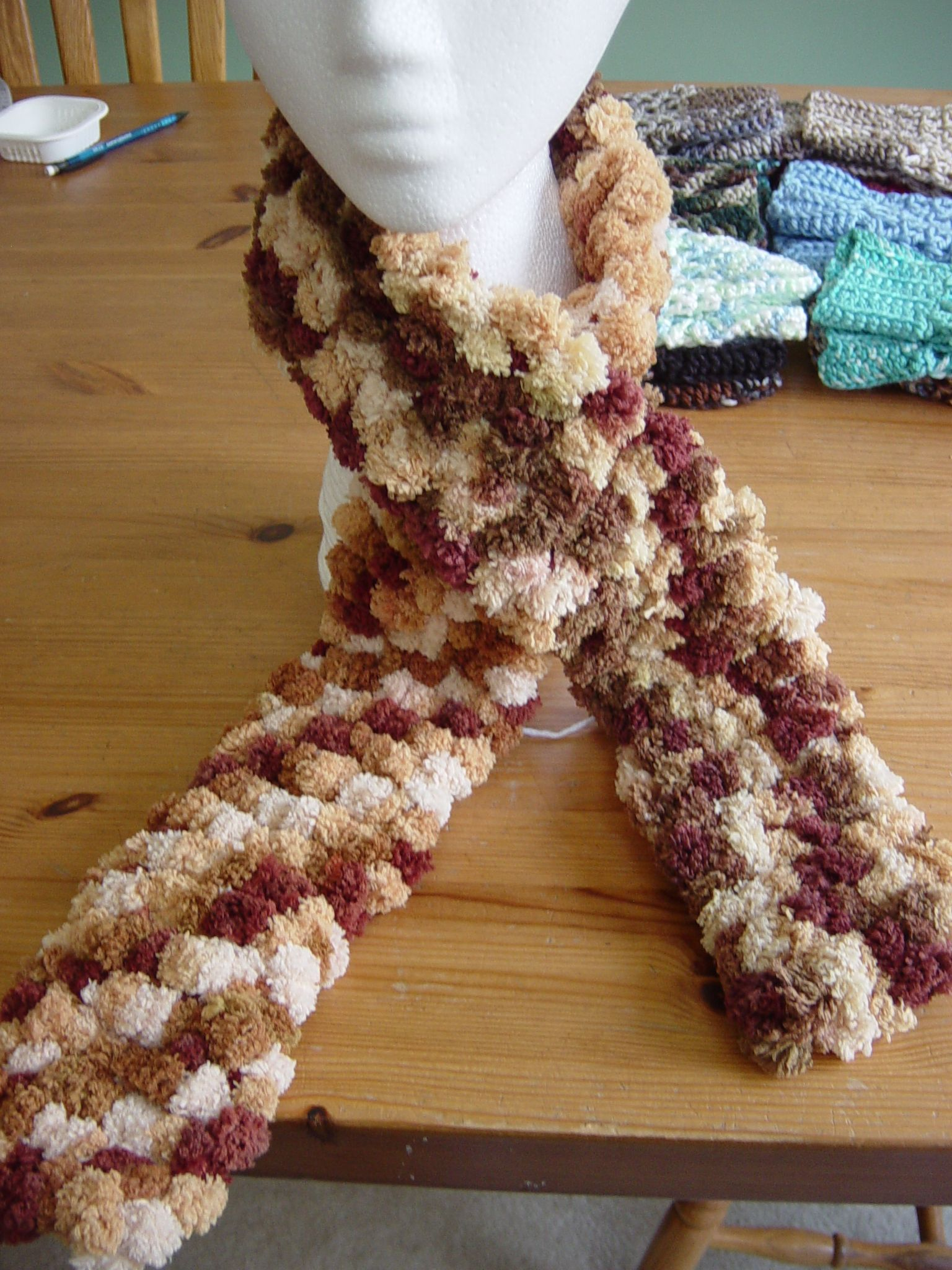 This is a crocheted pomp-a-doodle scarf. Pattern can be found on Red ...