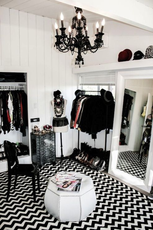 Bedroom Converted Into Closet Black And White Features Glossy Chandelier Over Ghost Chair Paired With Hex Ottoman Silver