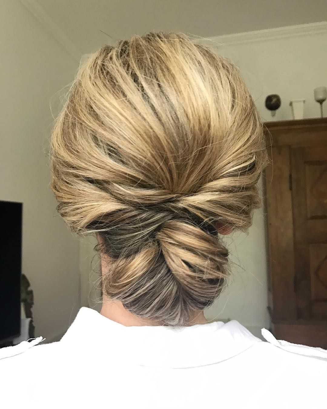 chignon ,messy updo hairstyle ,swept back bridal hairstyle ,updo hairstyles ,wedding hairstyles #weddinghair #hairstyles #updo