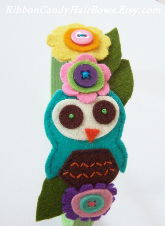 Multicolored Felt Owl Headband.    Lime formed headband with an embroidered turquoise felt owl adornment. Sweet and simple wool felt flowers in many colors have been hand cut and stitched with matching buttons and olive green leaves; this style fits most ages, 3 and up.    **An original design.  **Copyright 2009-2010.            **Please note that last photo is to show how this style fits. The headband in this listing is pictured in the first four photos.    **Looking for more unique hair…