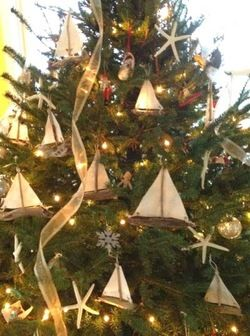 this is one of my favorite nautical christmas trees i love the driftwood sail boats