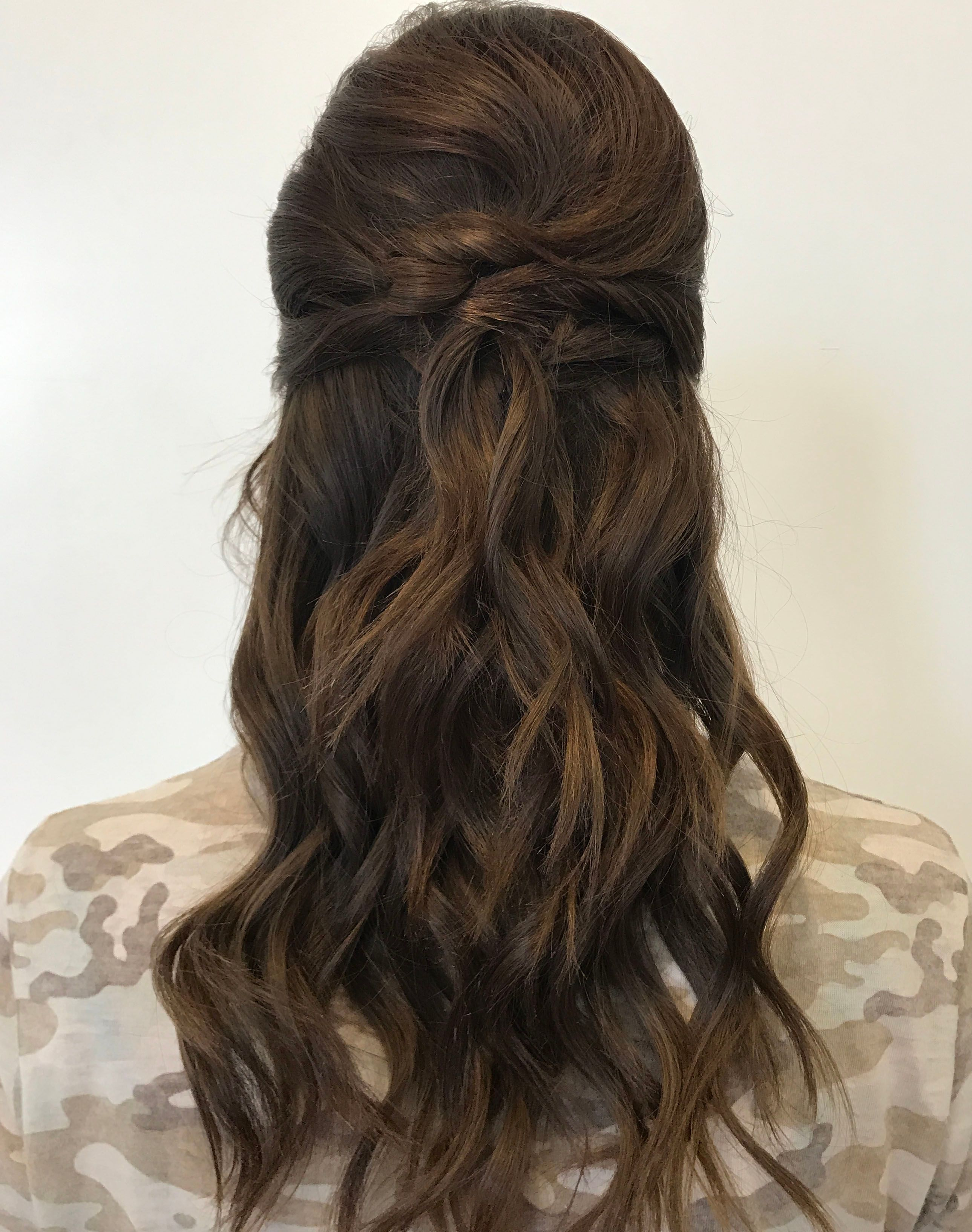 Half up half down knotted and curled bridal style
