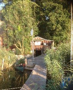 Bootshaus am Malchiner See mit eigenem Steg und Boot