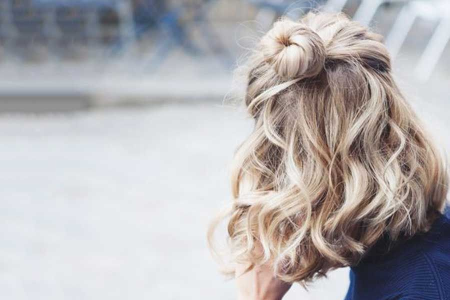 Half Back Bun A Half Back Bun Is A Casual Way To Style Your Hair For Everyday Wear Espeially On The Days When You Short Wavy Hair Hair Styles Short Hair Styles