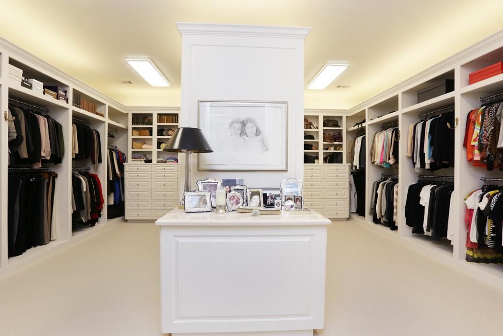 Her closet features built in cabinets chests