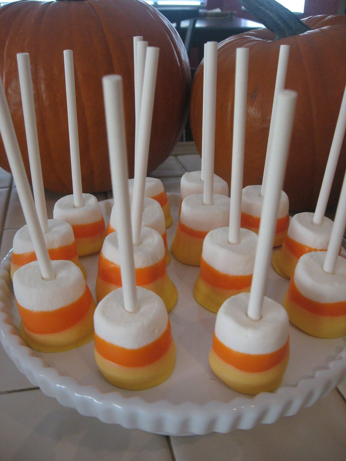 candy corn marshmallow pops... skewer a jumbo mallow on a cookie stick (you can find these at your local craft store or Walmart), and double dip the end of the mallow in orange and then in yellow (use candy melts or color white chocolate).  I LOVE THIS, so easy peasy. :)