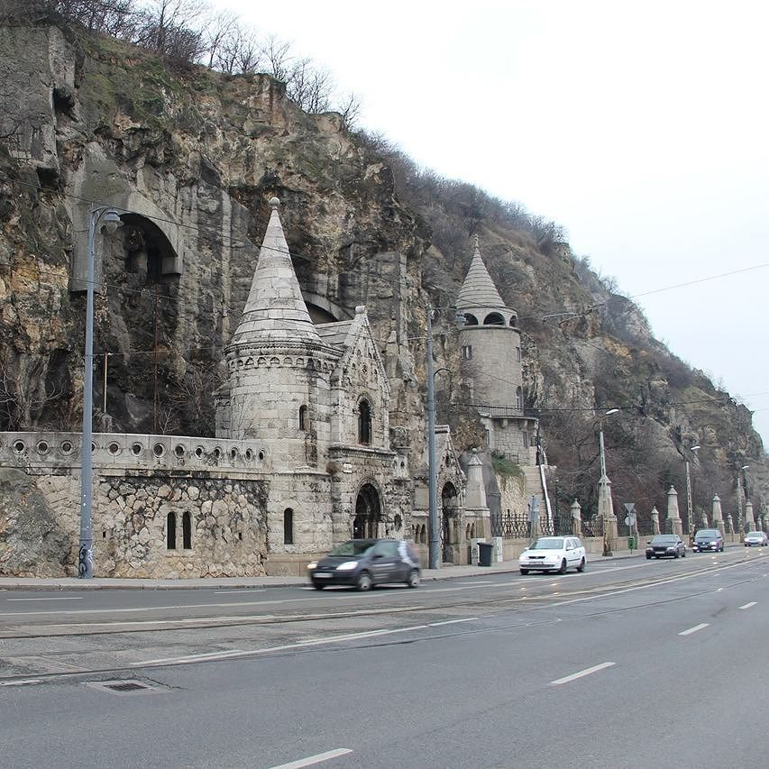 A castle structure merged with the rocks and along the road. Absolutely marvelous. I don't recall the location but it's definitely a sight! - #hungary #travelhungary #hungarytravel #budapest #travelbudapest #castle #road #whereisthis