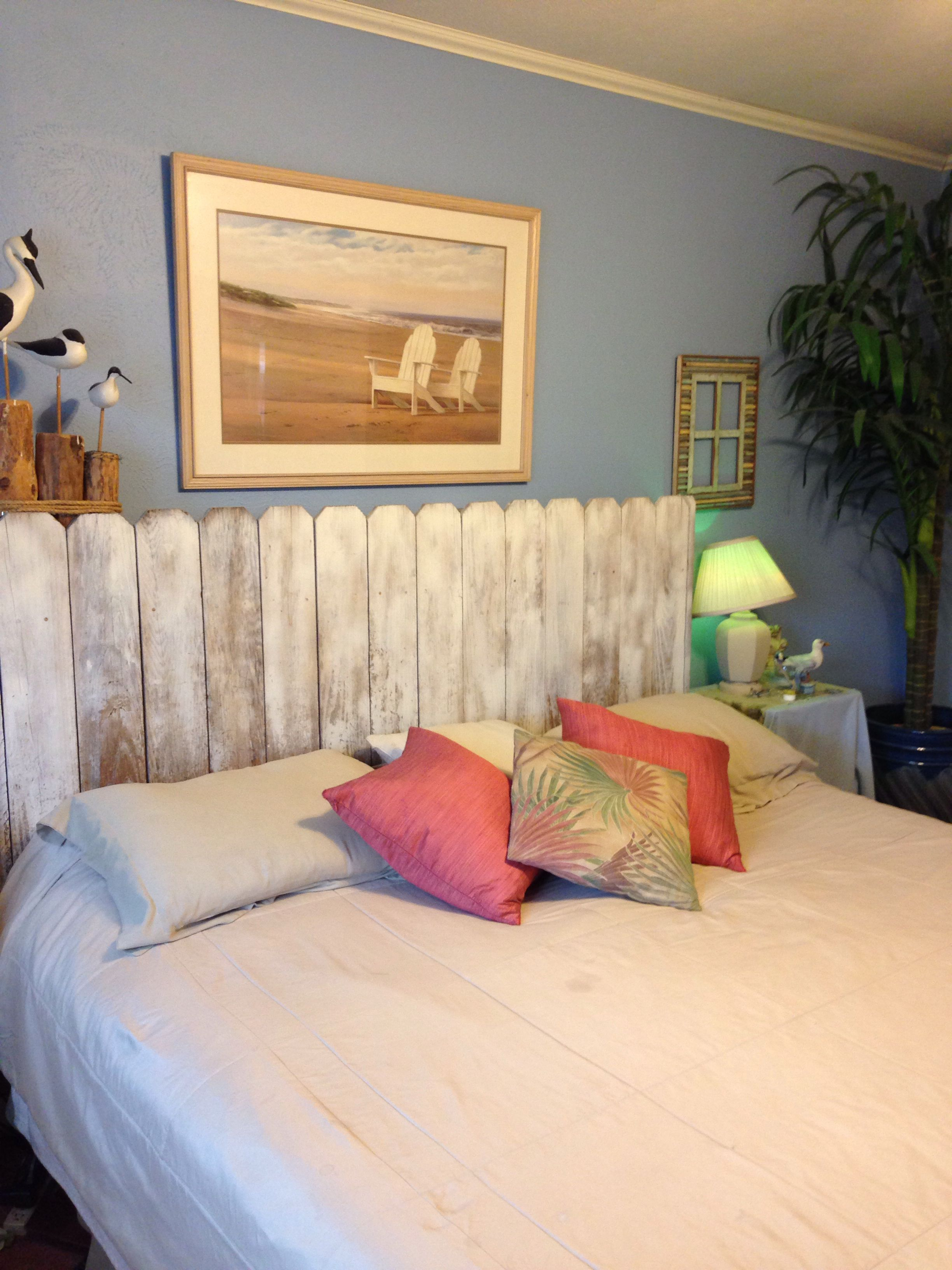 Diy headboard made out of whitewashed fence boards