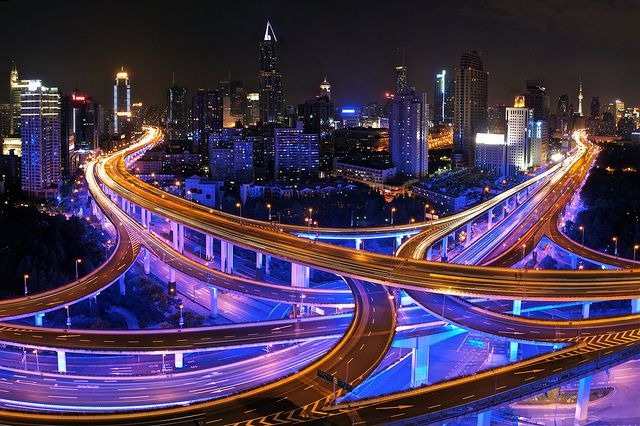 Surrounding People's Square and many parts of Shanghai is a beautifully illuminated highway network at night.