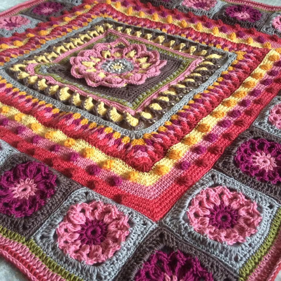 Crocheted plaid of motifs grandmothers square
