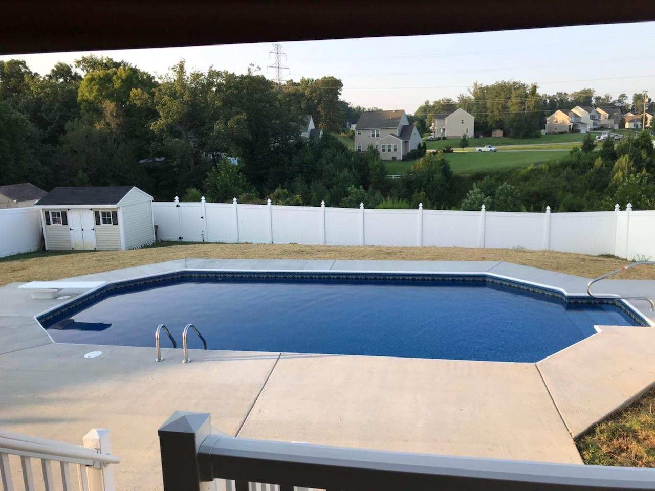 A Grecian Inground Swimming Pool With Our 6 Liner Stairs With An