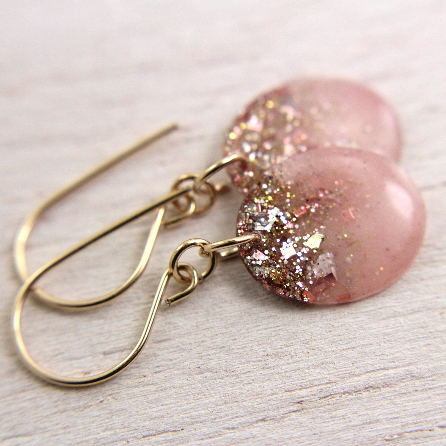 pink resin drop earrings with gold glitter and gold leaf on gold