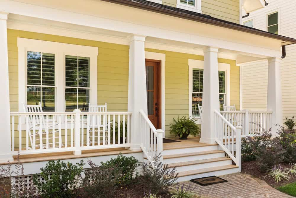 Yellow Siding With Red Brick House Exterior Color Schemes Brick Exterior House Red Brick House