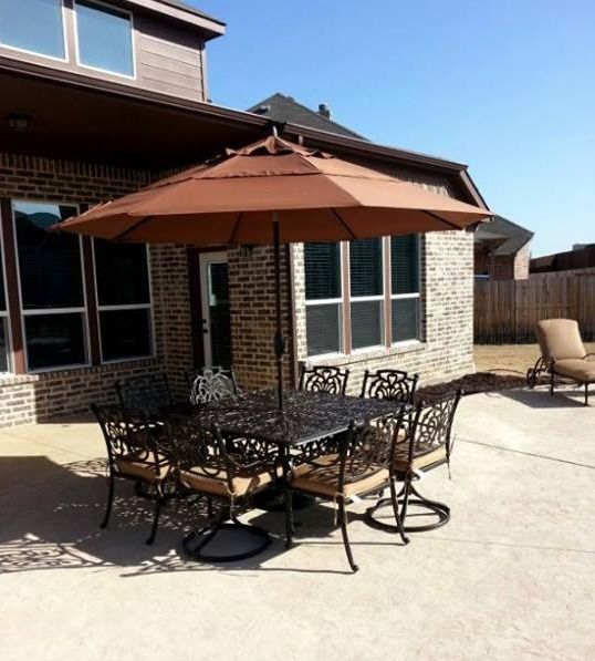 Treasure Garden S 11 Auto Tilt Umbrella Paired With St Augustine Dining Chairs And A Chateau 60 Dining Table From Hanamint With Images Patio Fireplace