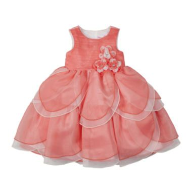 <p>Organza petals and faux rhinestone buttons highlight this beautifully-hued ballerina dress