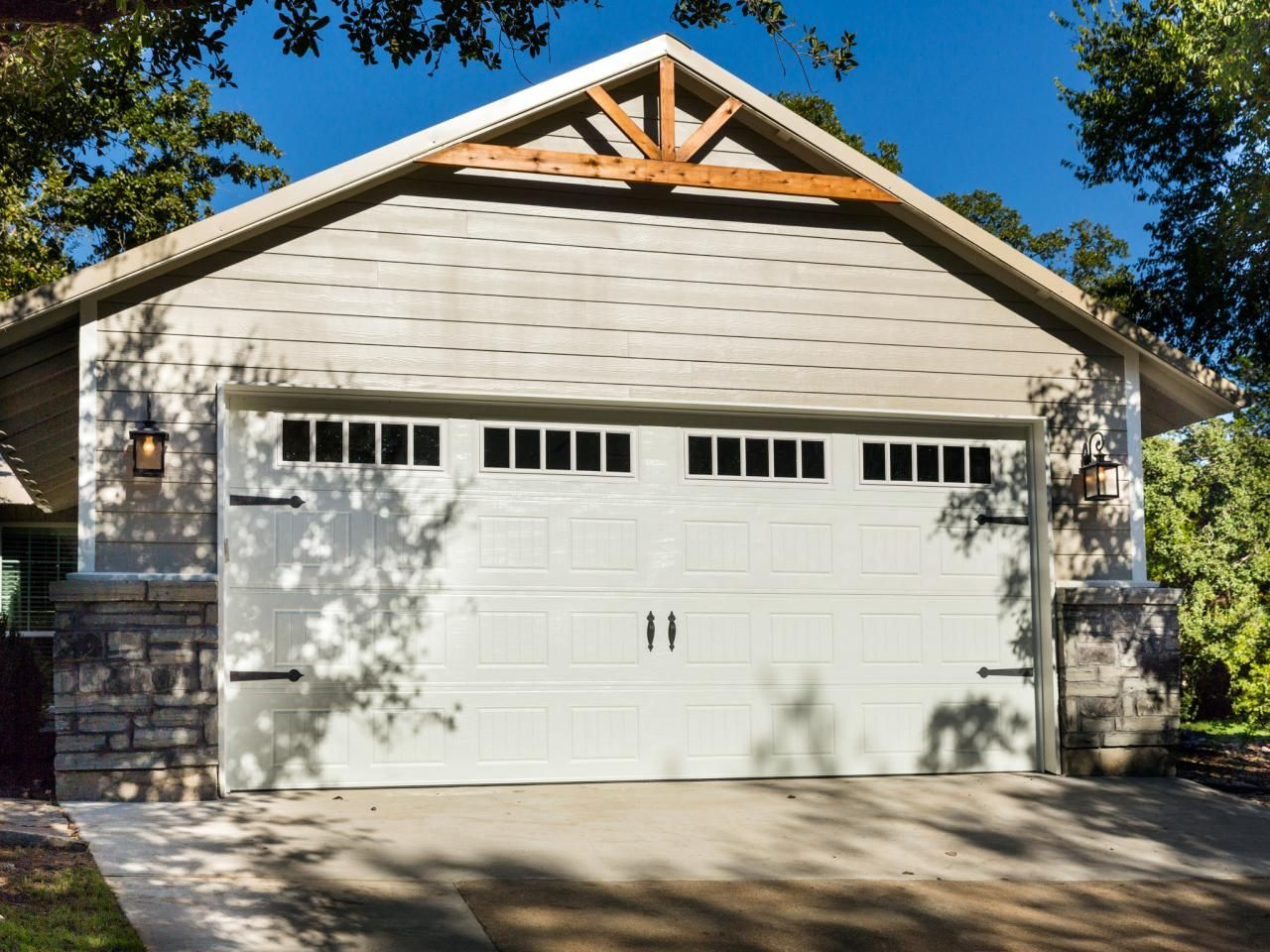 The details on the garage exterior, including stone and wood trim, add  character