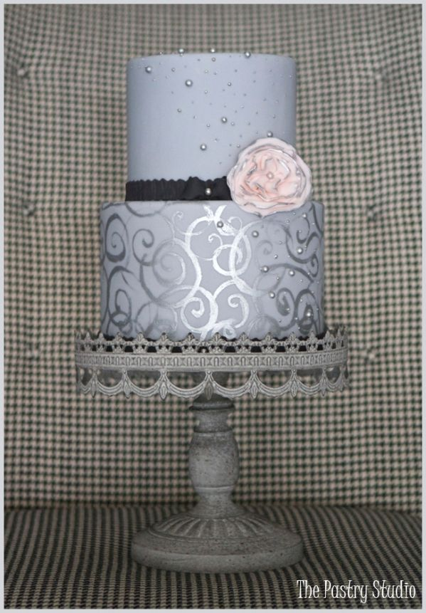A Grey and Silver Cake with a touch of Black & Pink