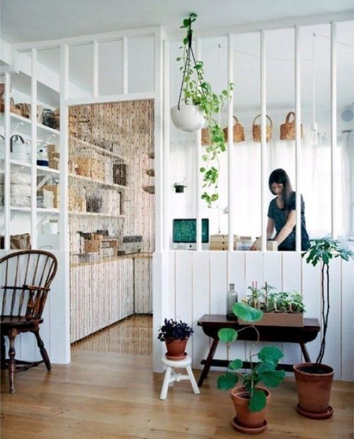 Interior Design White Celling Brown Wooden Armchair Partial Room Divider Potted Plants Yellowish