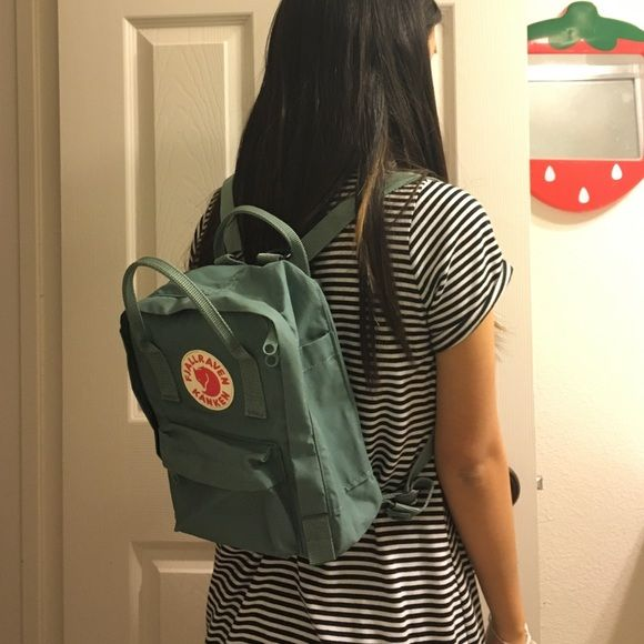 Fjallraven Kanken Mini Backpack (Frost Green) Frost Green mini kanken backpack. Barely used. It does has some punctured little holes on the sides of the backpack because I put pins/buttons on it (but you can barely notice it from far away). I decided to give this away because I found it to be too small for my liking. Nevertheless, you may like the cute smallness off it! It could be used as an everyday backpack. (: Fjallraven Kanken Bags Backpacks