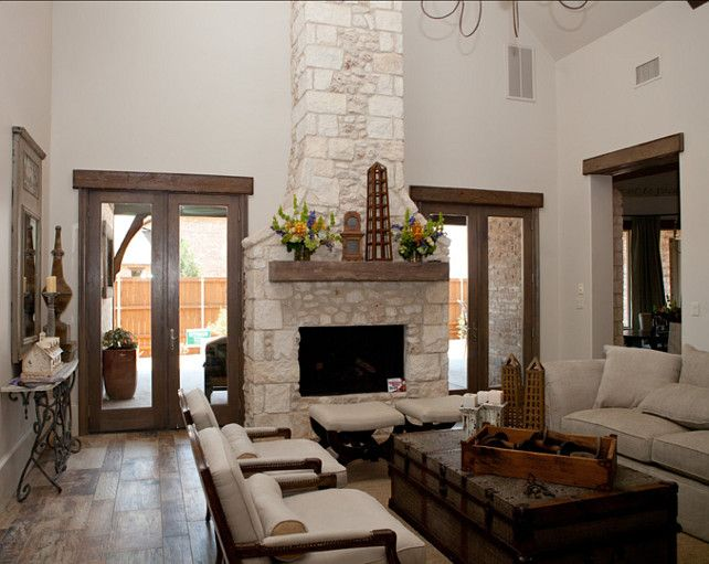 Rooms: White Texas Limestone Fireplace Contrasts With Dark Wood