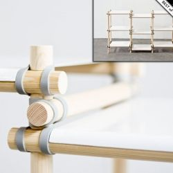 The Gummitwist System Consists Of Wooden Rods Painted