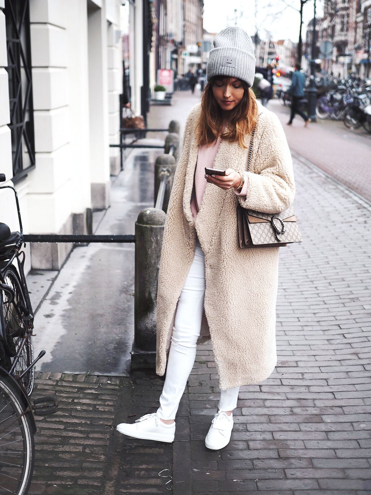 Grey beanie, cream teddy coat, white