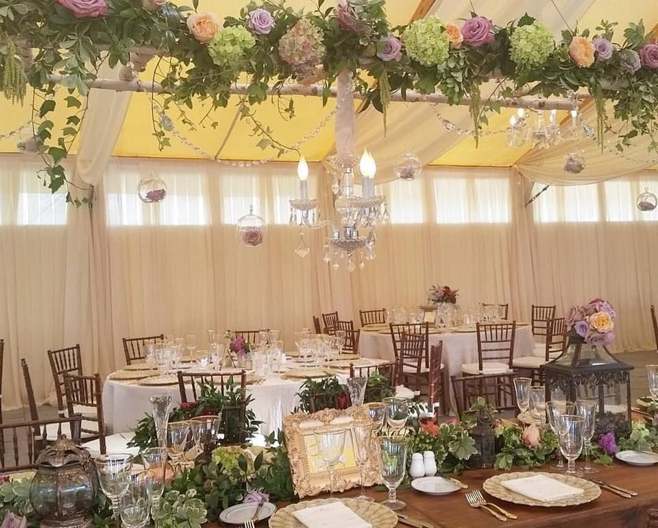 "An image of the head table from a ""Victorian Seaside Splendor"" wedding at Castle Hill Inn."